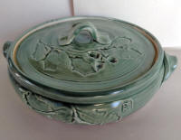 Blue-green glaze on casserole with Live Oak imprint.